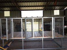 Multiple dog above ground dog kennel