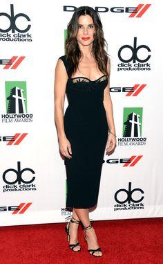 Sandra Bullock looks lovely in a sleek black dress. #fashion