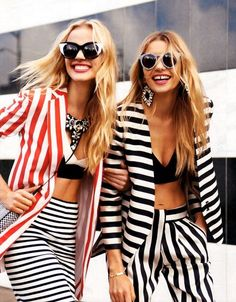 This girls are wearing a striped jacket and trousers  or skirt triped, too.