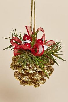 "Set of Four, 3"" Sparkling Gold Pine Cone Ornaments adorned with red berries and white shells, a sprig of faux pine and a sheer red bow and hanger. These little gold pine cones add a beautiful sparkle"