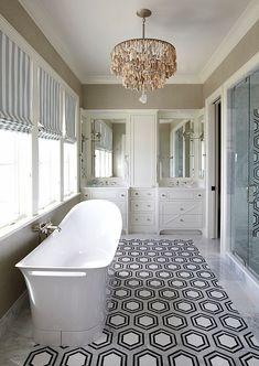 Hex Floor Tiles. The master bathroom features white, black and gray hexagonal tiled floor. The hex floors are New Ravenna Pembroke Tiles.…