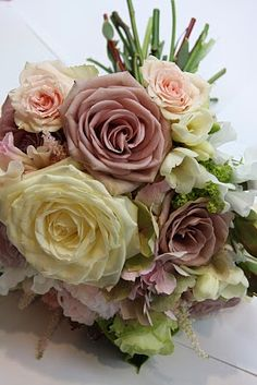 Amnesia roses are so beautiful and give this hand-tied it's antique lavender look...