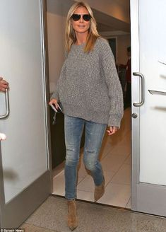 Heidi Klum wearing the grey Closed sweater, ankle boots and jeans