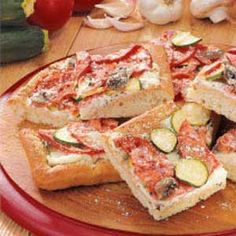 Garden Focaccia Recipe -Frozen bread dough is the convenient base for this herb-flavored flat Italian bread. These savory slices are a super appetizer at a summer gathering. It's a fun and delicious way to use up abundant garden tomatoes and fresh zucchini.