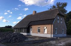 Even new houses are built to resemble the 200-year-old originals, thatched roofs…