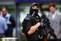 "UK Terror Threat Level Lowered To ""Severe"" As Police Tear Down Terrorist Cell Manchester Bombing, Bell The Cat, British Prime Ministers, Military Personnel, Tear Down, Conservative News, New Politics, The Washington Post, About Uk"