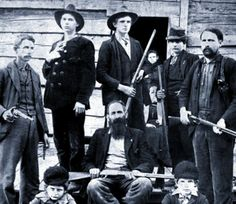 """The Hatfield boys. The patriarch of the family is seated in the middle--William """"Devil Anse"""" Hatfield--actually a wealthy man who owned his own timbering business."""