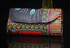 This is a beautiful vibrant eye catching purse. It perfect to add a pop of colour to everyday outfits or compliment occasional wear.  Its handmade design ensures that its design is unique and exclusive making it a one off.  The clutch is big enough to fit your phone, compact and lip gloss, keys and cards but still small enough to be held in one hand. The clutch has a snap closure and an inner compartment perfect for notes and cards.   This is a lovely clutch purse.  Measurements…