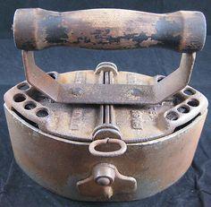 Antique charcoal sad iron