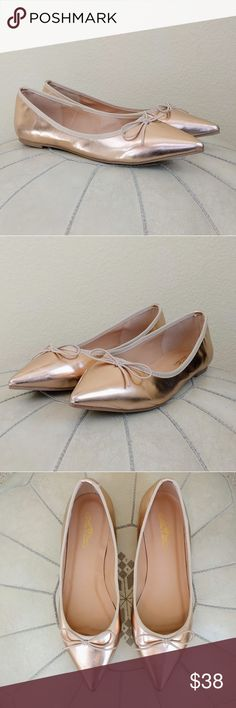 New Journee Collection Rose Gold 'Lena' Flats 9 Express your feminine style in these rose gold modern flats by Journee Collection. These classic flat shoes feature smooth uppers and fabric knit trim. Classic pointed toes with dainty bow accents and small block heels finish the design.  Extra padded insoles create comfortable wear that pairs perfectly with the eye-catching design on these wardrobe-essential flat shoes. These flats look great dressed up or down. New without box. Size 9 Journee…
