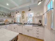 I'm in LOVE with the kitchen in this Cape Cod. I like how they used a light blue on the ceiling and double sinks? Yes, please!