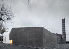 Arts centre pairs white-rendered concrete with volcanic stone - Menos é Mais Arquitectos and João Mendes Ribeiro