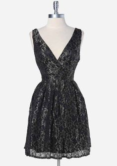 """Midnight Minuet Lace Dress 79.99 at shopruche.com. This magnificent and dignified black and gold lace dress can be worn for any formal event. The wrap-front and back give off a sleek allure and the hidden side zipper ensures a snug fit.  Self: 100% Polyester Contrast: 100% Polyester Lining: 95% Polyester, 5% Spandex Imported Waist: 26"""" 33"""" length from top of shoulder *All measurements taken fro..."""