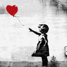 Young girl with heart balloon
