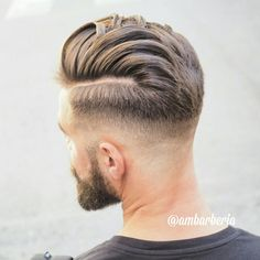 Men's square grad crop with a clippered side line with fade using mens firm hold gel.