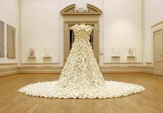 by artist Susie MacMurray: A wedding dress made out of 1400 rubber gloves turned inside out.