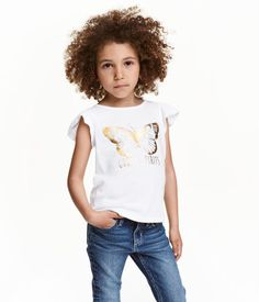 Check this out! Top in soft jersey with a printed design and short, ruffled sleeves. - Visit hm.com to see more.
