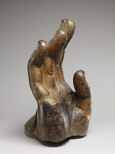 Right Hand of Buddha,  Northern Qi dynasty (550–577) Date: ca. 550–560 Culture: China (Northern Xiangtangshan, North Cave) Medium: Limestone with pigment and gilding Dimensions: H. 20 1/2 in. (52.1 cm); W. 15 in. (38.1 cm); D. 20 in. (50.8 cm). The Metropolitan Museum of Art