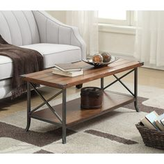 Give your space a charming makeover with this Justina Coffee Table with Magazine Rack. Featuring a grooved top panel paired with decorative metal corner protectors that give this piece elegant character. The bottom shelf allows plenty of space for you to store and display your favorite collectibles. Constructed from a powder coated metal frame with slightly scrolled feet ensures that this piece will guarantee style and stability.