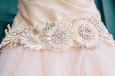 The beaded belt featured flowers and rhinestones.  Venue:Magnolia Plantation and Gardens  Dress Designer:Lazaro