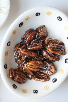 A combination of balsamic vinegar, sea salt, and brown sugar turns pecans into a toasty, addictive snack that's perfect for nibbling alongside apéritifs.