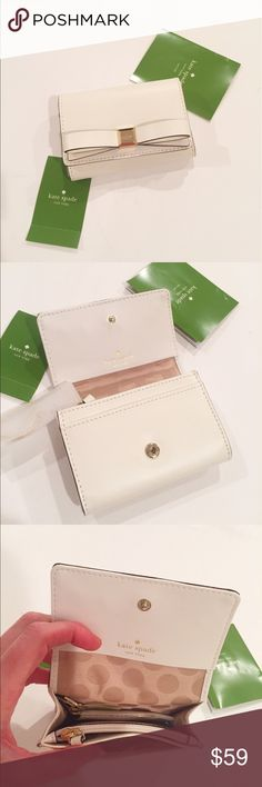 NWTs Kate Spade Darla Wallet //FIRM PRICE// NWTs Kate Spade Darla Montford Park Smooth.  Features Front flap snap closure Slip pocket and ID window in the back, slip pocket in the front 14 Karat Gold hardware. Interior 2 Open compartments separated by zip pocket, Slip pocket on back wall Key chain link is attached. Size 4.5 in(W) X 3 in(H) X 1 in (D) retails around $83.00 Colour Cream/Gold kate spade Bags Wallets