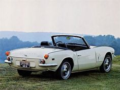 Triumph Spitfire MkIII ... USA specification. Those hub caps are awful