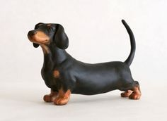 Dachshund dog sculpture in polymer clay by Leslie Sealey