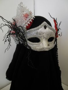 Silver Masquerade Mask Adult Mardi Gras Mask Fall Leaves Black Twigs Custom Mask  NEW WITH TAGS- BUY IT NOW, receive in time for Halloween!!!!!!!!!!!!!!!!!!  BRAND/MAKER- VIOLET CASTLE COSTUMERY Elegant silver fabric mask with silver lace enhancement festooned with fall leaves, black twigs and metal jacketed rhinestones. Black beads hang down on left side of mask. Elastin band on backside. No stick  CONDITION- New created by Violet Castle Costumery  Can be combined with other auction ite...