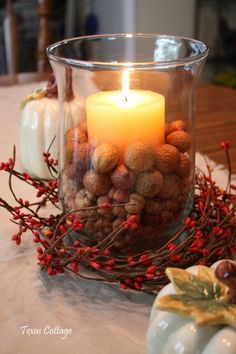 Great for a harvest centerpiece, instead of candles fill with flowers and set tealights around the vase