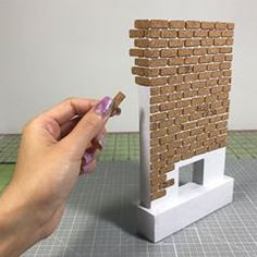 miniature dolls Laying down the cork bricks.slow and steady I almost want to keep this unpainted because the cork adds such a cool effect . Miniature Crafts, Miniature Houses, Miniature Dolls, Craft Stick Crafts, Wood Crafts, Diy Wood, Craft Sticks, Diy Dollhouse, Dollhouse Miniatures