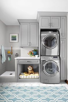 Laundry room with stacked washer and dryer, plus built in dog bed. Love the grey cabinets. A simple rearrangement of task areas takes advantage of vertical space to make cleanup easier for both two- and four-legged family members