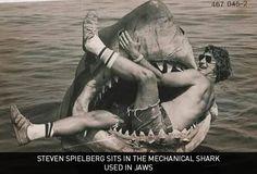 Steven Spielberg sits in the mechanical shark