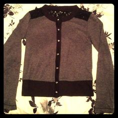 Black and Gray Button Up Cardigan with Lace Princess Vera Wang long sleeve button down shirt with lace on back. Used but not worn very much, in great condition! Has sliver heart buttons and still has the spare button on the inside tags. Size medium, true to size! NO trades NO PayPal Vera Wang Tops Blouses