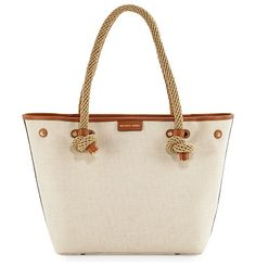 "Maritime medium canvas beach tote bag by MICHAEL Michael Kors. MICHAEL Michael Kors canvas tote bag with leather trim. Braided rope top handles, 8. 8"" drop. Open top with lobster-c..."