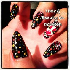Gel nail extensions and hand painted nail art done at hair & beauty in dornoch
