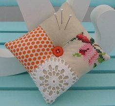 patchwork doily cushions with pearl embellishments