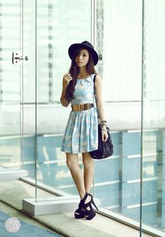 Cloud dress with black hat, shoes, and bag. Gold belt.