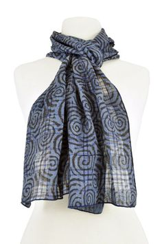 This is a ClothRoads-original scarf made from fine, handwoven silk fabric produced by Creative Bee in Hyderabad, India. The fabric is also hand-dyed and block-printed with natural dyes. It's lightweight with an excellent drape. The edges are finished with an overlock stitch.