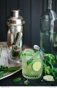 A refreshing green gin cocktail with basil, mint and cucumber! https://www.theprettyblog.com/food/green-gin-tonic-recipe/