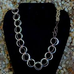 Hand cut by me.  Chain necklace made if tri color:silver,brass,and copper. Has Chain Maile linked brass chain in back.