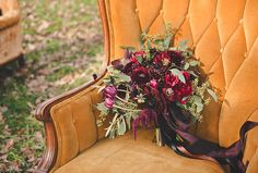 Wedding Colour Ideas: Marsala | Add a pop of marsala in front of your white or ivory wedding gown by carrying a bridal bouquet in various shades of the burgundy hue. This Holly Heider Chapple Flowers arrangement combines deep wine-red and burgundy-black tones, and includes tulips, ranunculus, peony, amaranthus, chocolate cosmos and burgundy red smokebush, plus green seeded eucalyptus.  #wedding #flowers