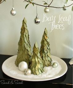 100 Days of Christmas – Day 86 - Make your own unique holiday centerpiece with this tutorial from Sand & Sisal.  Would you believe this is made out of styrofoam and bay leaves?  Might be nice with a little gold paint too ;)