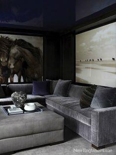 masculine living room..high gloss deep blue ceiling oversized photography, gray velvet sectional..exquisite!