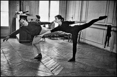 "David Seymour  FRANCE. Paris. 1956. Audrey HEPBURN with dance instructor Lucien LEGRAND during the filming of ""Funny Face."""