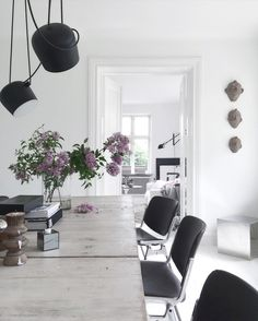 The 31st of MAY...| I'm bringing in the last lilacs from the garden.....taking it slow after a busy and funny day in Stockholm yesterday. Thank you @interiorbyjana and @josefin_karsbergnetz for opening up your lovely homes to me and @fotografthereseromell . |  #diningroom #interior #inspiration #home #athome #myhome #flos #vintage #blackandwhite #whiteinterior #lilacs #summer by bohemdeluxe