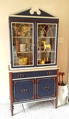 General Finishes Coastal Blue & Millstone milk paint were used to give this 1930's china cabinet a designer look guaranteed to be the center of attention...