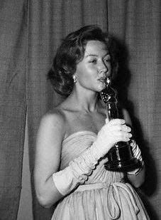 Gloria Grahame kisses her Oscar for Best Supporting Actress.... The Bad and the Beautiful. She played the ditzy wife of Jonathon Shields...powerful Hollywood producer (Kirk Douglas).