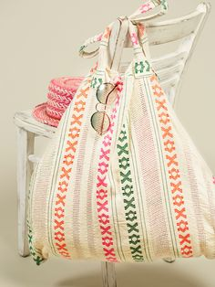 Waikiki Convertible Towel Tote | The easiest and chicest way to have the most effortless beach day, this convertible bag is inspired by beautiful hand woven fabrics made on the south coast of India. Unzip the sides to reveal a full sized towel. Top handles and zip pocket.