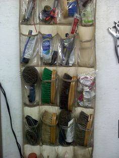 A shoe bag works great to hold brushes, etc at our barn.
